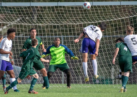 Pennfield defenders look to stop a shot by Lakeview's Josef Quispe during the first game of the 2018 All-City tourney this week.
