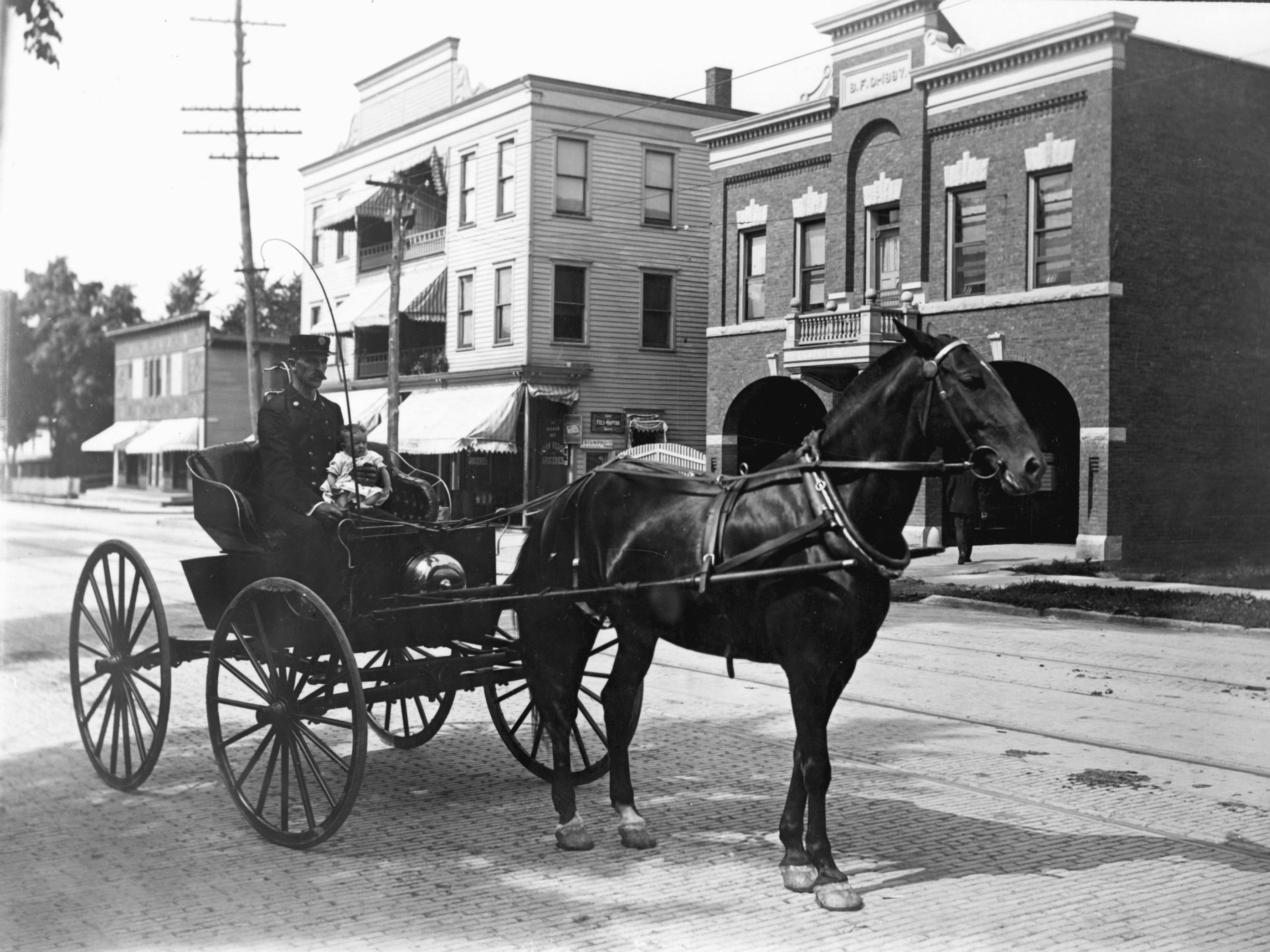 A young rider takes in the scenery in a horse and buggy as it travels along DeRussey Street on the south side of Binghamton around 1900. While the name of the street would become South Washington Street in 1941, the Binghamton Fire Department Station No. 5 is in the background. While the street changed names, the station looks much the same today as the Number 5 Restaurant.