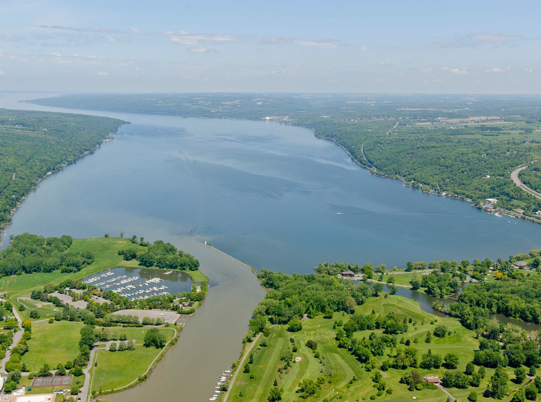 People visiting Cayuga Lake are advised to look out for peculiar blue-green spots in the water. Cayuga Lake with Cass Park, left,  Newman Golf Course, lower right, in May of 2014. Phosphorus is a concern in Cayuga Lake because it promotes algal growth, and algae has impaired southern Cayuga Lake for swimming. The impairment led Cayuga's Southern end to become listed in 2002 for violating the U.S. Clean Water Act.