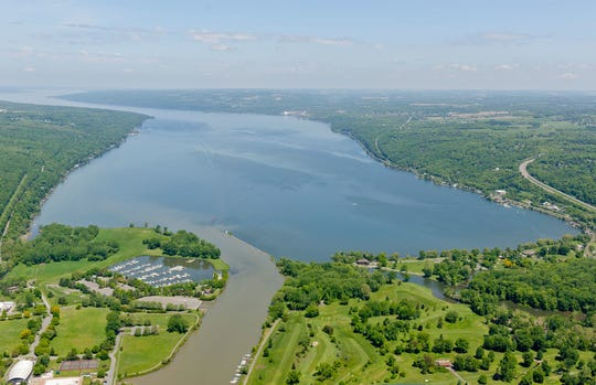 Cayuga Lake, with Cass Park, left, Newman Golf Course, lower right, in May of 2014. Phosphorus is a concern in the lake because it promotes algal growth, and it has impaired part of the lake for swimming. The impairment led to the southern end being listed in 2002 for violating the U.S. Clean Water Act.