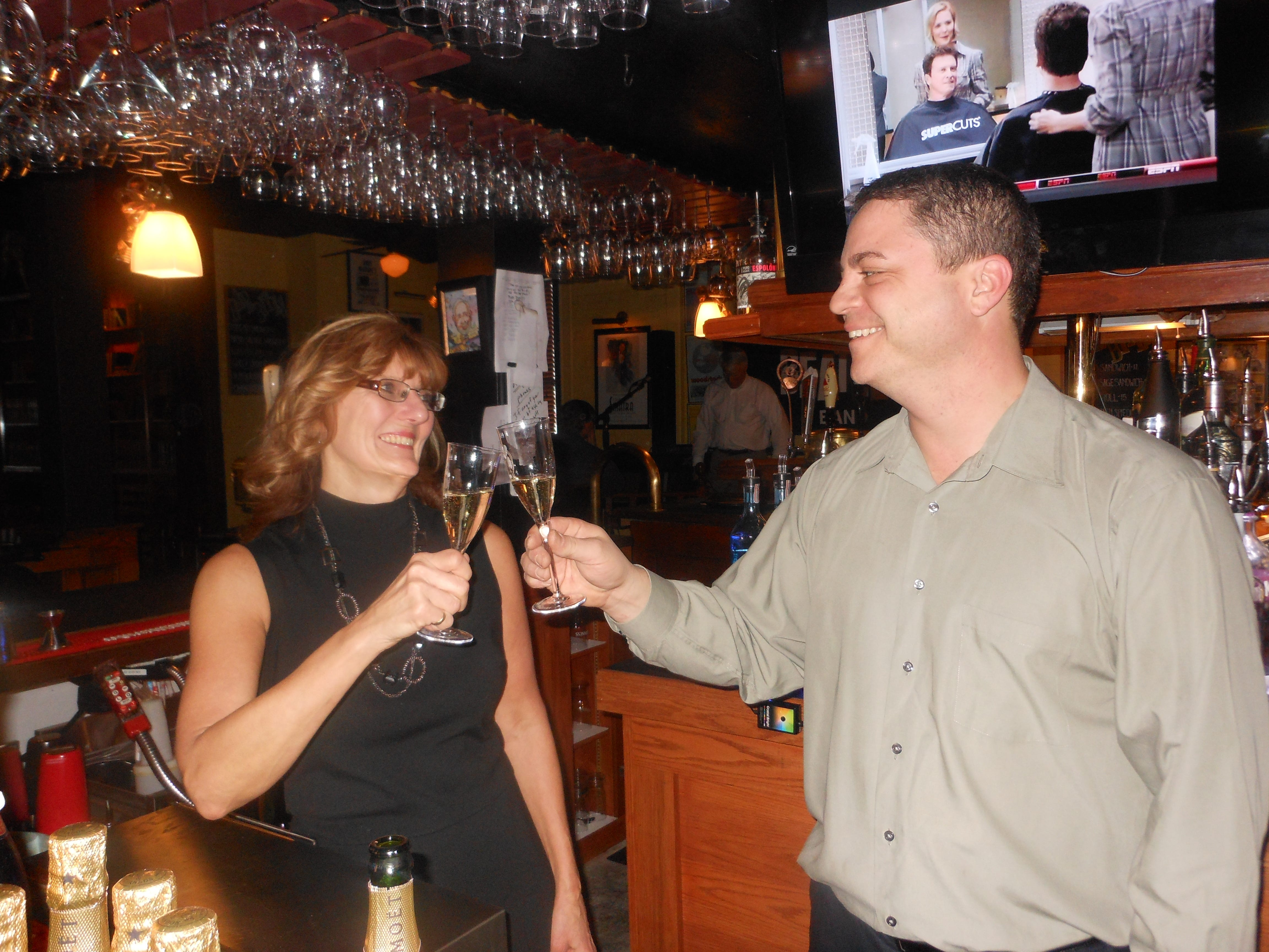 Mike Tulsey, general manager at Number 5 Restaurant in Binghamton, and Paula Alter, assistant general manager, get a head start on the New Year's Eve celebration in 2011.