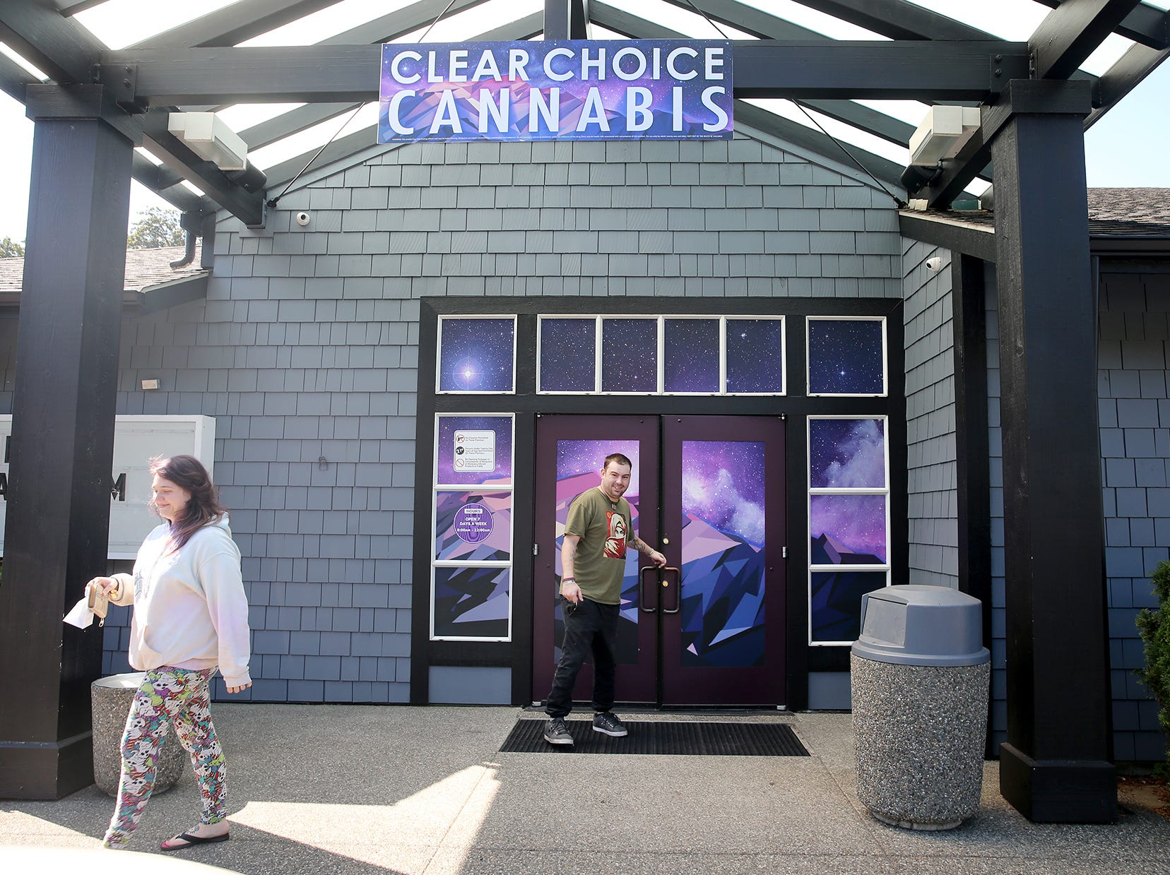Ashley Fresh, left, and David Morton leave Clear Choice Cannabis in East Bremerton on Monday.