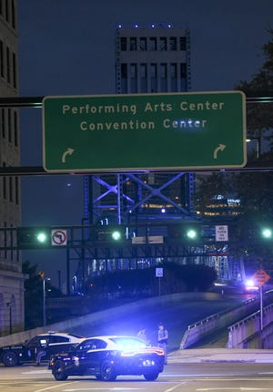 Police vehicles block one of the bridges leading to Jacksonville Landing where four people were killed and several wounded at a Madden 19 tournament.