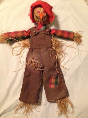 This small version of a scarecrow was constructed back in the 1970s, with David's well-worn corduroy pants, and Mary Lee's shirt cut down and remade for the stuffed fellow. Raffia gave him form and a piece of burlap became a hat.