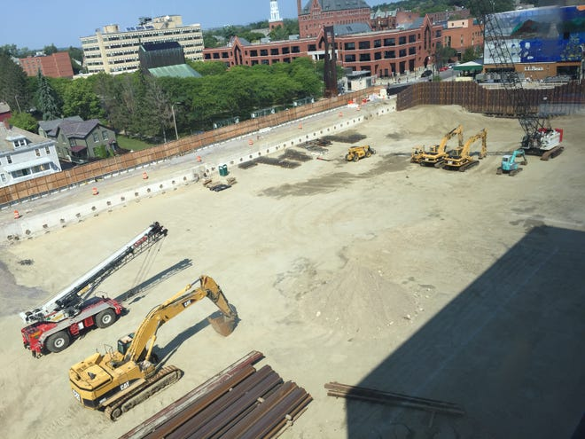 Heavy equipment sits idle on Friday, Aug. 24, 2018, on the construction site for Burlington CityCenter, the redevelopment project for the former Burlington Town Center mall in downtown Burlington.