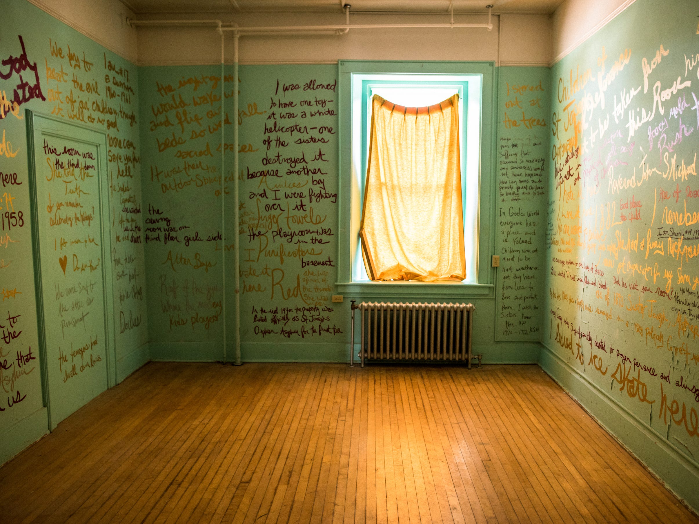 """Quotes found written all over the now-closed St. Joseph's Orphanage in Burlington, Vermont, were painted on the walls of a second-floor room as part of an artwork by Abbey Meaker titled """"The Writing Room."""" It was a portion of an installation-based exhibition called 'An Order"""" organized by Meaker in 2015."""