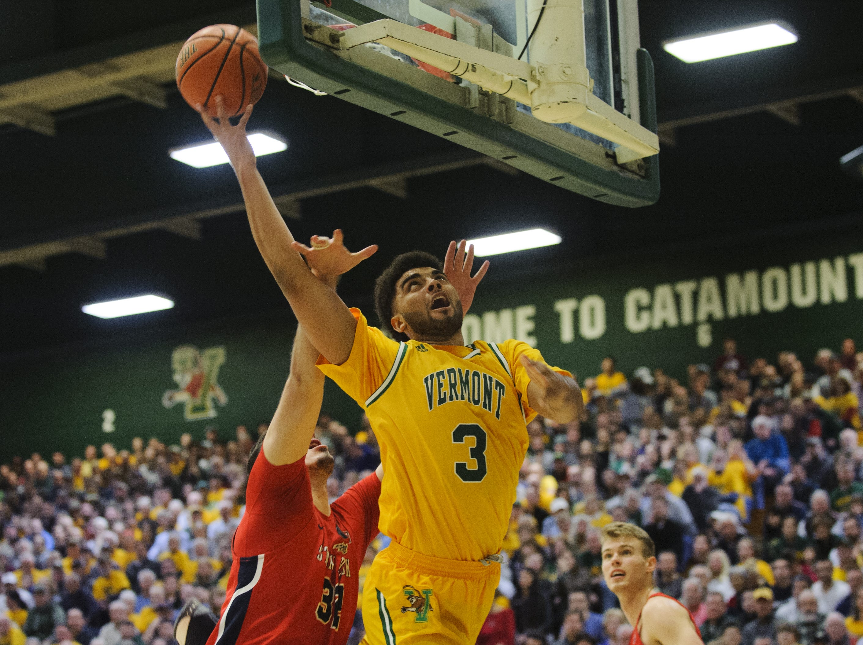 Vermont's Anthony Lamb (3) leaps for a lay up during the America East men's basketball semifinal game between the Stony Brook Seawolves and the Vermont Catamounts at Patrick Gym on Tuesday night March 6, 2018 in Burlington.