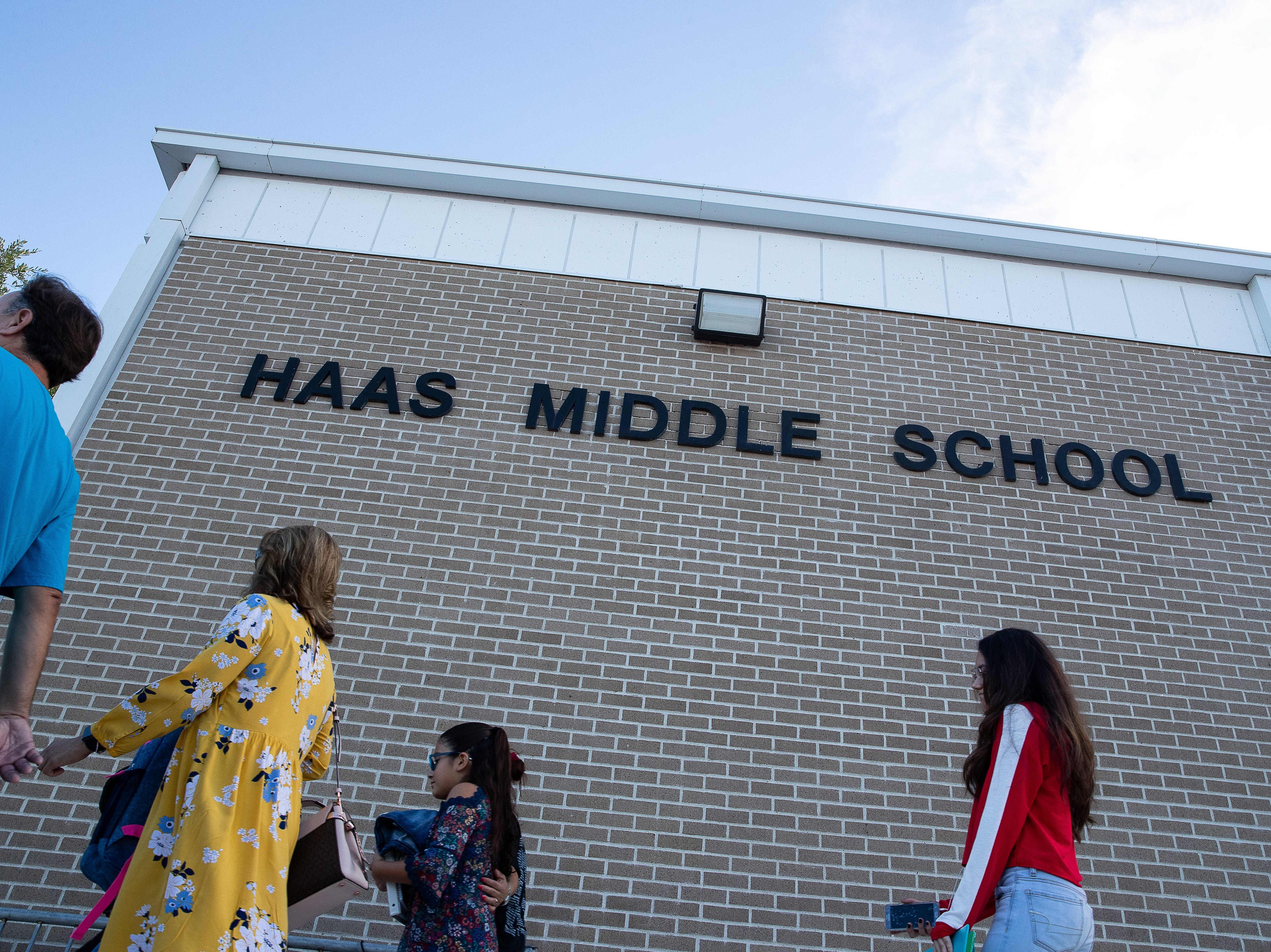 Students and parents arrive Haas Middle school on the first day of school, Monday, Aug. 27, 2018.