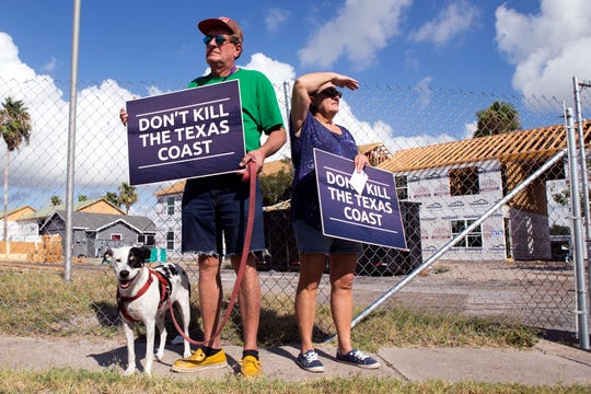 Lola, Robert and Patricia Branch and their dog, Lola, stand outside an apartment complex being rebuilt after being damaged by Hurricane Harvey in Aransas Pass. The couple own a home and business and commercial property in Aransas Pass and joined other homeowners, business owners and elected officials from throughout the Coastal Bend in protesting windstorm insurance rate increases on Monday, August 27, 2018.