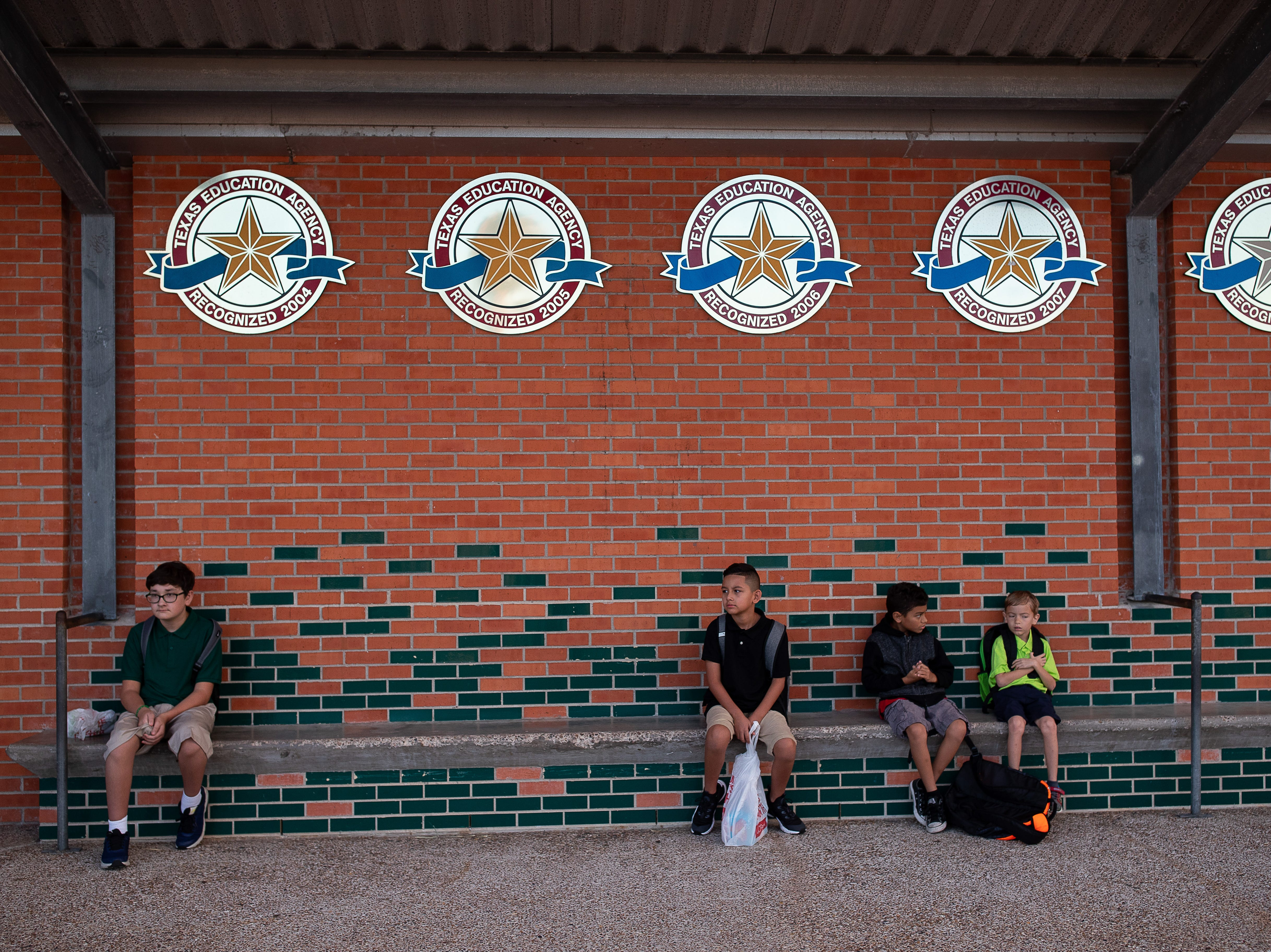Students wait outside Dawson Elementary on the first day of school, Monday, Aug. 27, 2018.