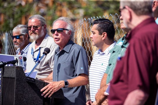 State Rep. Todd Hunter (center) speaks during the community rally to protest windstorm insurance rate increases on Monday, August 27, 2018 in Aransas Pass. The community rally was organized by the United Corpus Christi Chamber of Commerce and other members of Coasted Bend United, which is a network of seven local Chambers of Commerce.