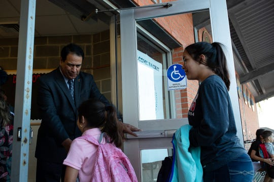 Corpus Christi Independent School District Superintendent Roland Hernandez greets students and parents at Dawson Elementary on the first day of school, Monday, Aug. 27, 2018.