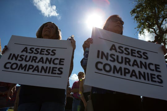 Lynn Blumenfeld (left) and Pat Lizcano join other homeowners, business owners and elected officials from throughout the Coastal Bend in Aransas Pass outside an apartment complex being rebuilt after being destroyed by Hurricane Harvey to protest windstorm insurance rate increases on Monday, August 27, 2018. The community rally was organized by the United Corpus Christi Chamber of Commerce and other members of Coasted Bend United, which is a network of seven local Chambers of Commerce.