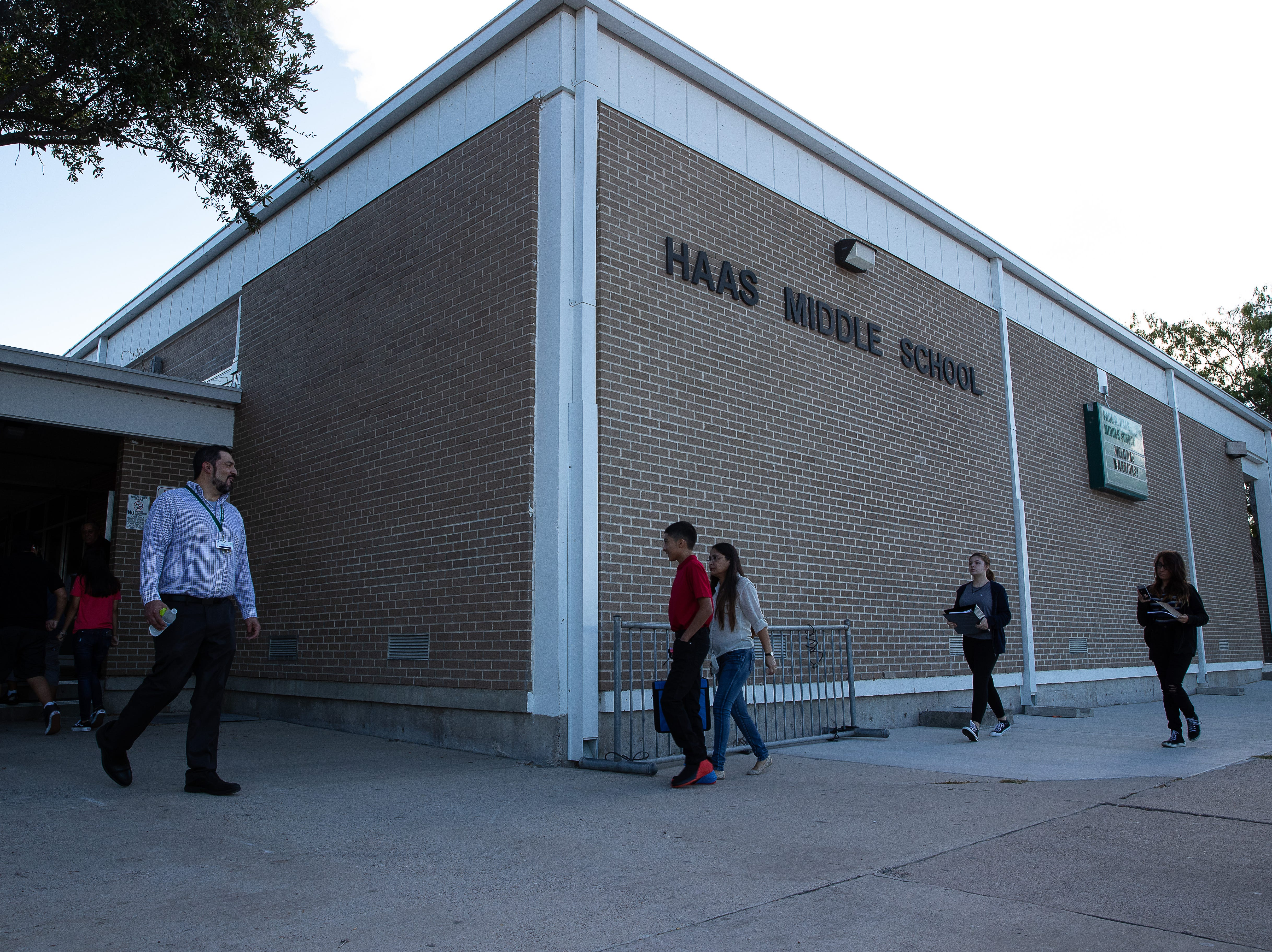 Students arrive Haas Middle school on the first day of school, Monday, Aug. 27, 2018.
