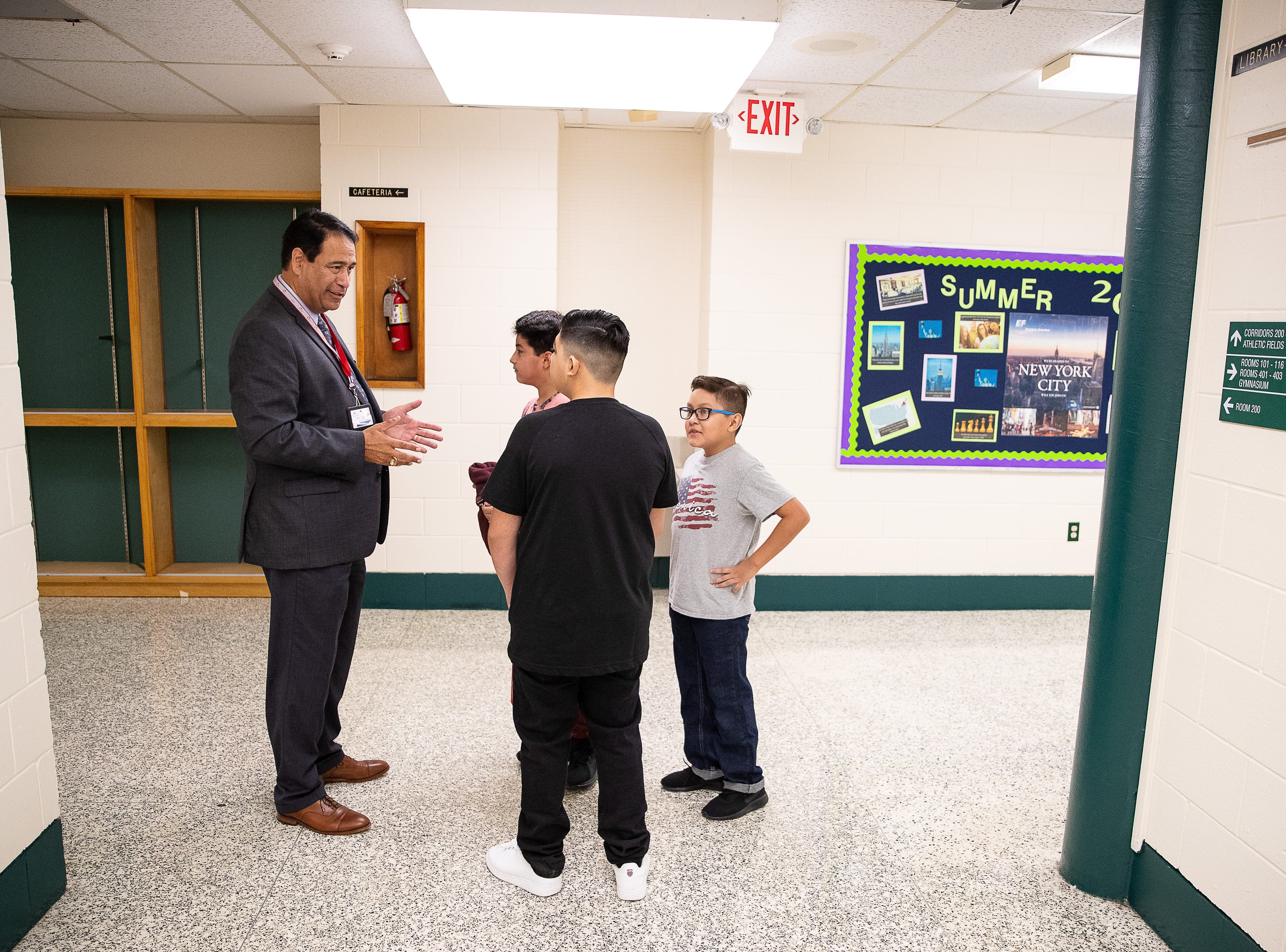 Corpus Christi Independent School District Superintendent Roland Hernandez talks to students in the hallway before the start of the school day Haas Middle School on the first day of school, Monday, Aug. 27, 2018.