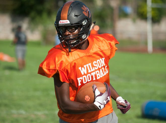 Woodrow Wilson senior receiver/defensive back Stanley King runs a drill during football practice on Aug. 23. King will play at the University of Louisville next year on scholarship.