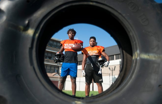 Woodrow Wilson juniors Fadil Diggs, left, and Muheem McCargo stand for a portrait during football practice on Aug. 23. The two have garnered major Division I scholarship attention.