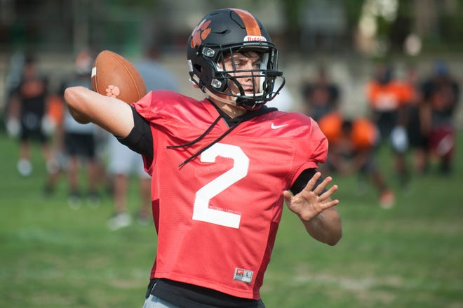 Woodrow Wilson senior quarterback Nick Kargman throws a pass during football practice at Woodrow Wilson High School in Camden on Thursday, August 23, 2018.