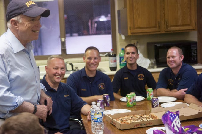 John McCain speaks to Chillicothe Fire Department firefighters in the kitchen of the fire station on Wednesday, August 6, 2008. McCain brought pizza for the employees during his unannounced stop and thanked the firefighters for their service, specifically thanking members of the military and their spouses.
