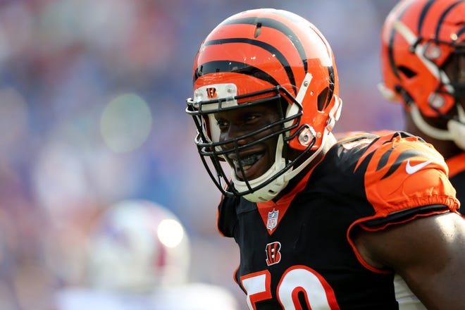 Cincinnati Bengals defensive end Carl Lawson (58) smiles after a sack in the second quarter during the Week 3 NFL preseason game between the Cincinnati Bengals and the Buffalo Bills, Sunday, Aug. 26, 2018, at New Era Stadium in Orchard Park, New York.