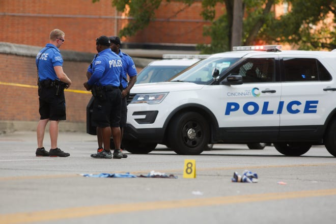 Police investigate a triple shooting in the West End Monday afternoon.
