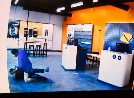 James Clay, 20, is seen on a TV camera footage provided by Cincinnati Police at the Mobile Boost store where he robbed and severely beat a store clerk.