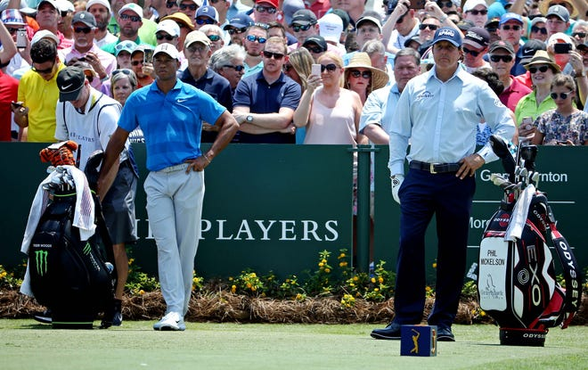 Tiger Woods and Phil Mickelson on the first tee during the first round of The Players Championship golf tournament at TPC Sawgrass - Stadium Course.