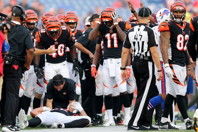 Cincinnati Bengals tight end Mason Schreck (86) lays on the turf after a hit in the fourth quarter during the Week 3 NFL preseason game between the Cincinnati Bengals and the Buffalo Bills, Sunday, Aug. 26, 2018, at New Era Stadium in Orchard Park, New York.