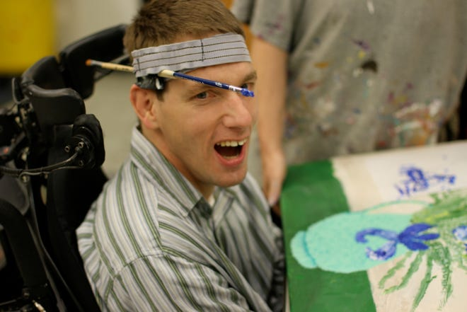 Brad Goldman is a Matheny student who paints by holding his brush in a headband.