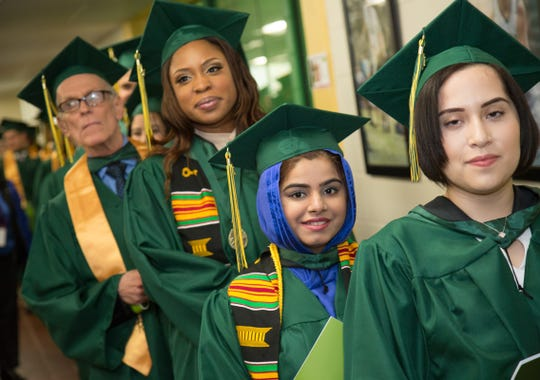Graduates line up at RVCC's May 2017 Commencement.