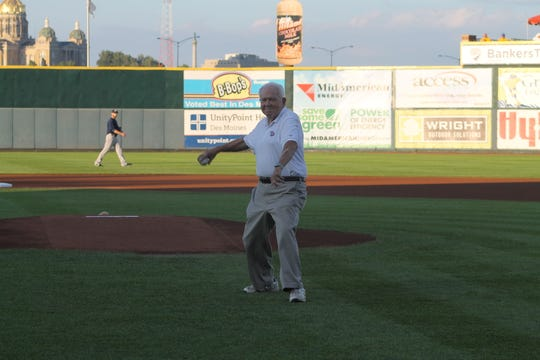 Red Hollis throws out the ceremonial first pitch at an Iowa Cubs game in 2014.