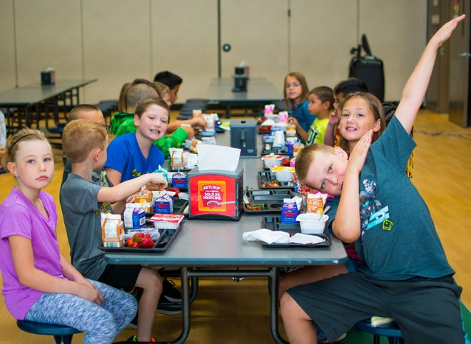 Children enjoy breakfast on their second day of school on Aug. 24 at Altoona Elementary School.
