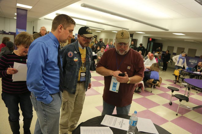 Site leaders add up the numbers during a Democratic caucus at Indianola High School on Feb. 1, 2016.
