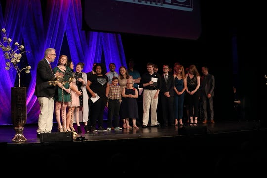 """Director John Viars, left, accepts the 2018 Cloris Award for Best Musical on behalf of the cast and crew of """"Ragtime,"""" produced by the Des Moines Community Playhouse, at this year's Cloris Awards ceremony Sunday night at Hoyt Sherman Place in Des Moines."""