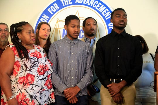 Laural Clinton, her son Jared Clinton, and Montray Little at a news conference Aug. 27, 2018 announcing a lawsuit filed against the Des Moines Police Department and the officers involved after Jared Clinton and Little were allegedly racially profiled during a July traffic stop.