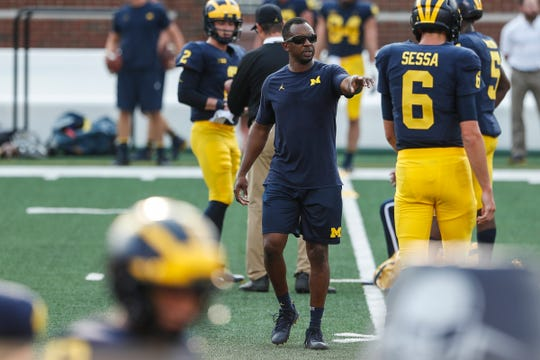Michigan assistant Pep Hamilton talks to players during an open practice at the Michigan Stadium in Ann Arbor, Sunday, Aug. 26, 2018.