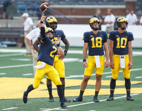 Michigan quarterback Shea Patterson throws a pass during an open practice at Michigan Stadium in Ann Arbor, Sunday, Aug. 26, 2018.