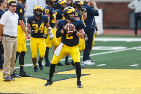 Michigan quarterback Shea Patterson looks to pass during an open practice at Michigan Stadium in Ann Arbor, Sunday, Aug. 26, 2018.