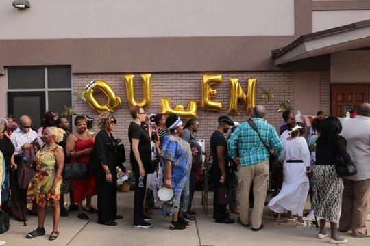 People wait in line for a gospel tribute concert for the late Aretha Franklin at New Bethel Baptist Church in Detroit on Monday, August 27, 2018.