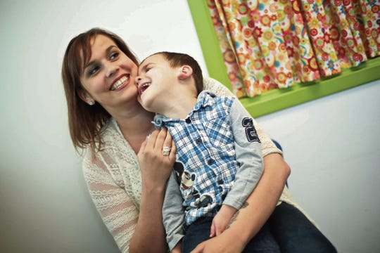 Erica Hammel of St. Clair Shores hugs her son, Wyatt Rewoldt, after a speech-therapy session in April.