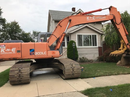 A wrecking crew gets ready to tear down Erica Hammel's house in St. Clair Shores on Monday, Aug. 27, 2018.