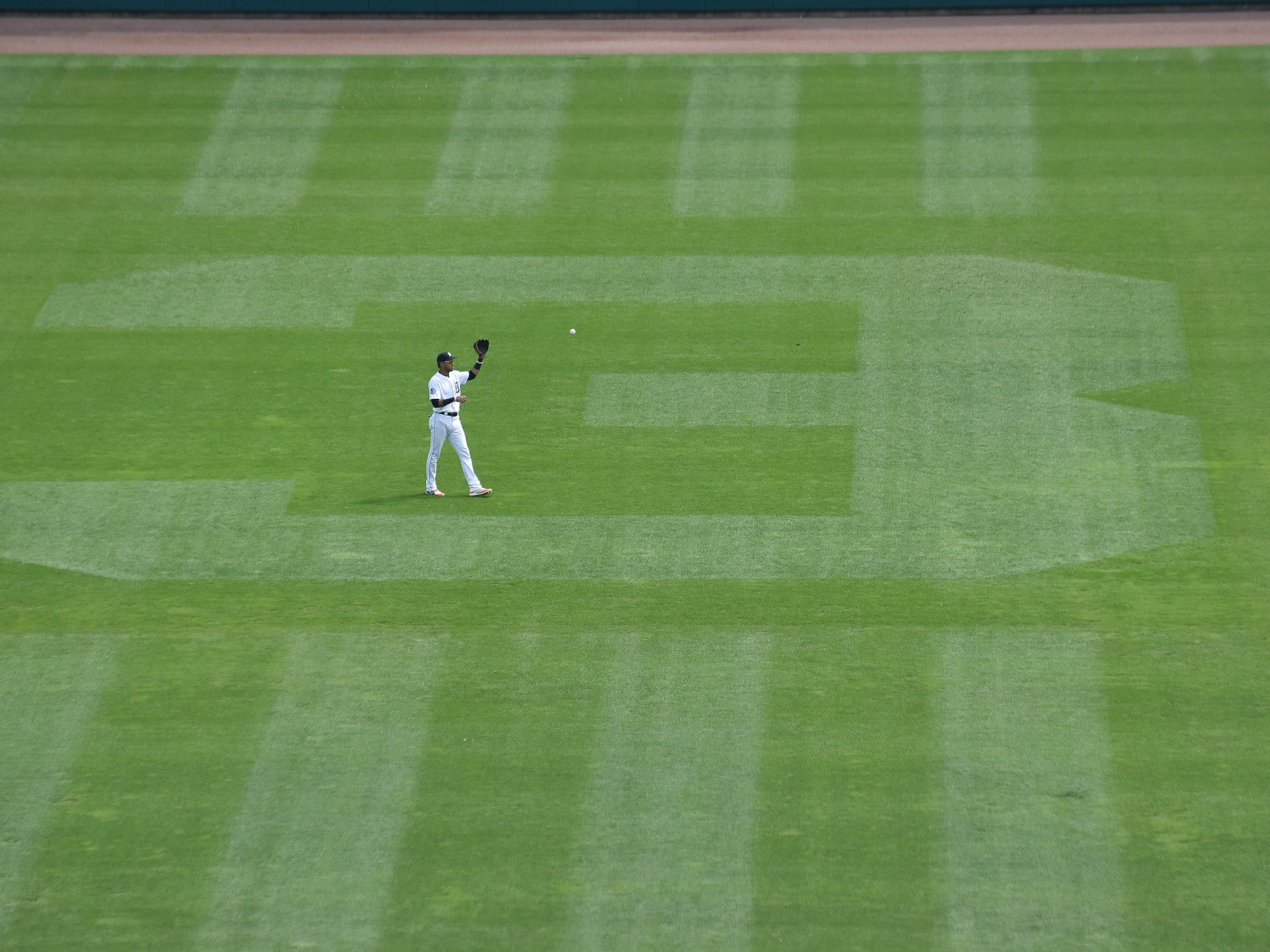 Tigers center fielder Victor Reyes warms up before the fifth inning. A 3 was cut into center field to honor former Tigers shortstop Alan Trammell whose number is being retired.