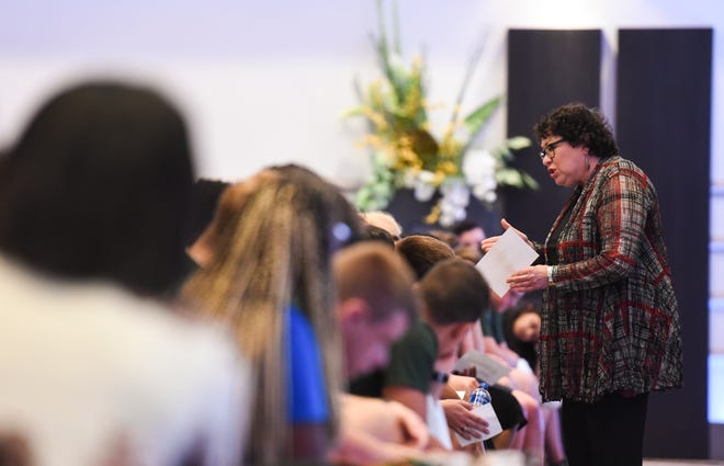 U.S. Supreme Court Justice Sonia Sotomayor, right, mingles among students on the campus of Michigan State University at the Kellogg Center on Monday.