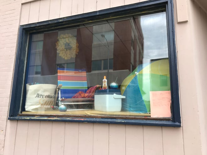 The window display at 11 E. Second St. emulates the feel of the soon-to-open tanning salon.
