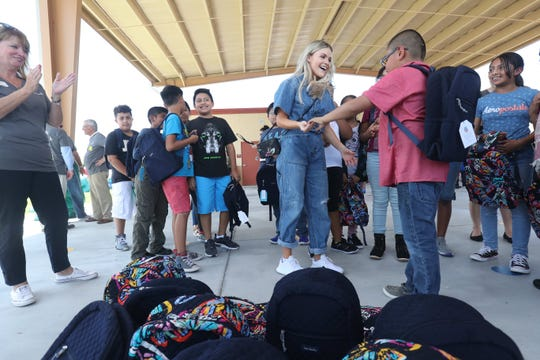 Blessings in a Backpack partnered with Vera Bradley to donate 600 backpacks to students at Tice Elementary. Every Friday the backpacks are filled with food for the students. Witney Carson from Dancing with the Stars is touring with Vera Bradley and was on hand to distribute the backpacks to students.