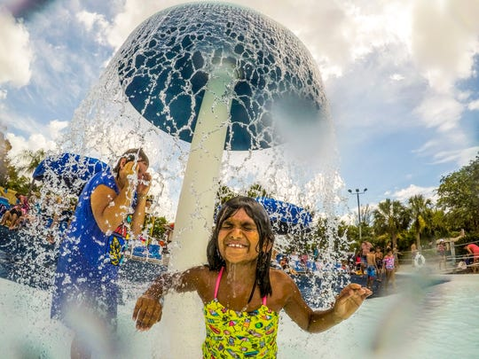 Judy Custer of Michigan was in town visiting her family including her granddaughter, Makara Custer, 7 of Fort Myers. Makara and her family just moved down here. They took a break and played in the splash pad area.  How did summer 2018 go? Locals and visitors flocked to SunSplash in Cape Coral Saturday, August 25, 2018.