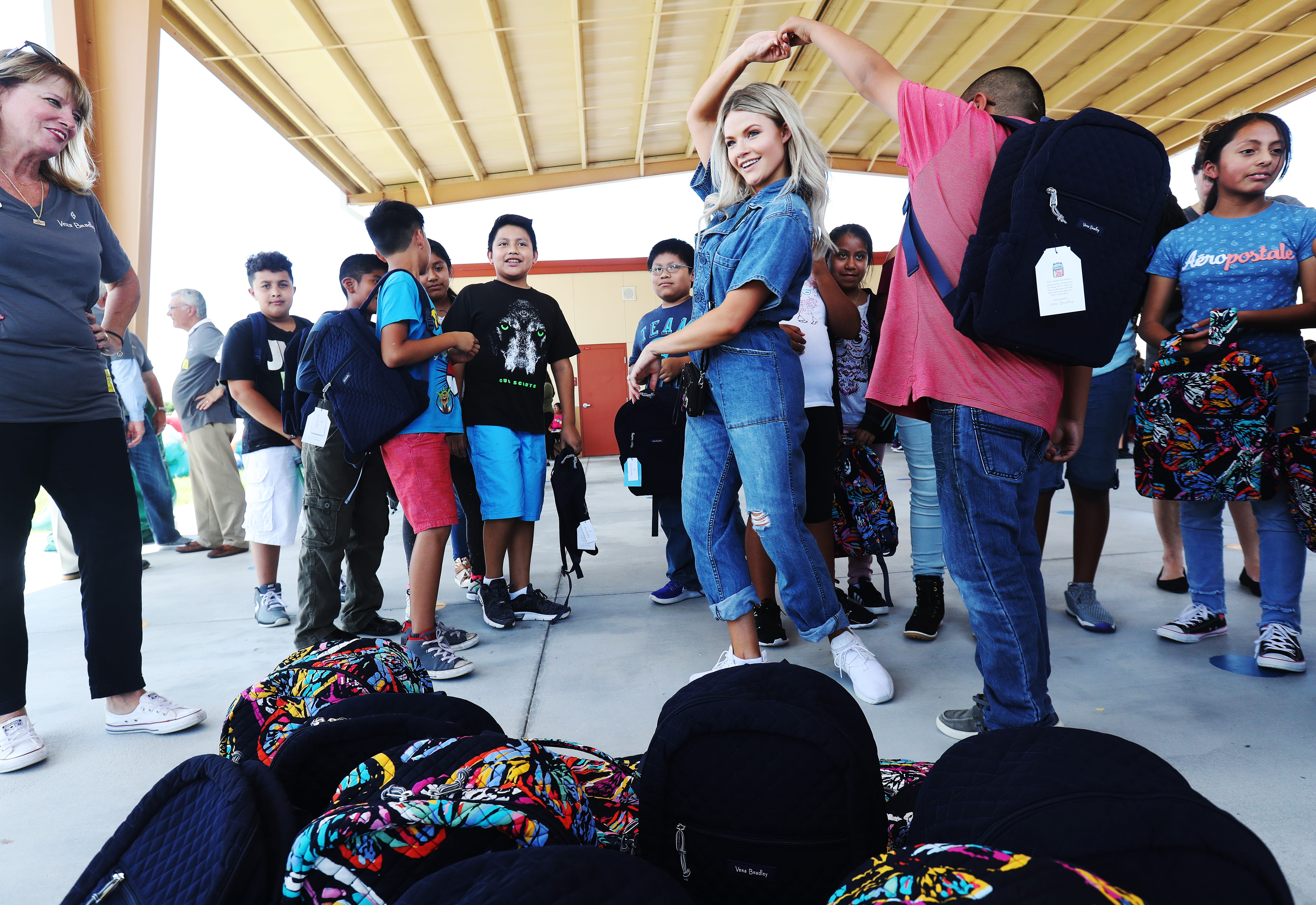 tice students receive vera bradley backpacks and a day of fun