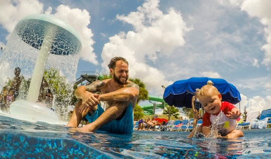 Jonathan Salinas, of Buckingham, enjoys watching his 11-month-old son Jayden play in the water during a trip to Sun Splash.