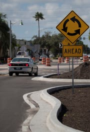 A driver makes its way towards the latest roundabout constructed in Cape Coral, located at the intersection of SE 47th Terrace and Vincennes Blvd. as part of the new streetscape project downtown on Monday, August 27, 2018.