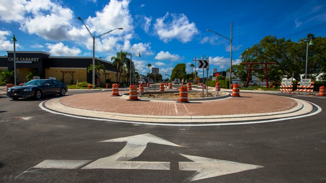 A driver makes its way through the latest roundabout constructed in Cape Coral, located at the intersection of SE 47th Terrace and Vincennes Blvd. as part of the new streetscape project downtown on Monday, August 27, 2018.